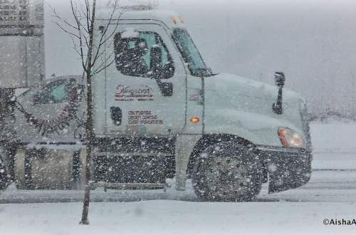 Tractor-trailer powers through blizzard