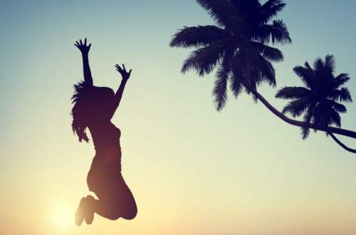 silhouette of girl jumping with excitement