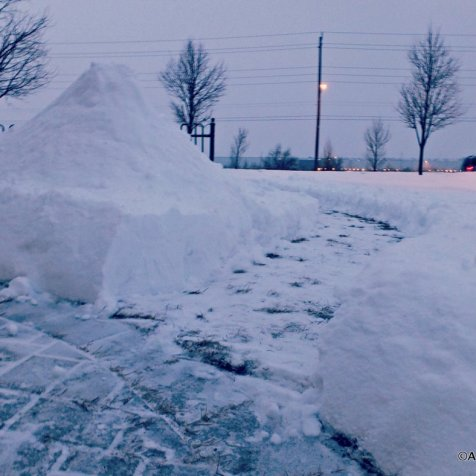 Path cut into snowbanks in Canada