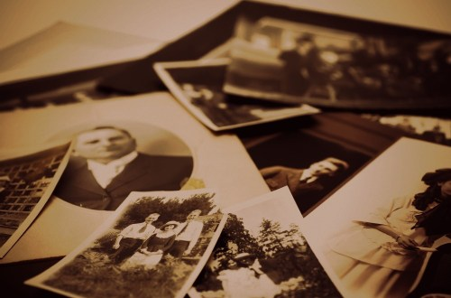 Closeup of a pile of vintage family photos