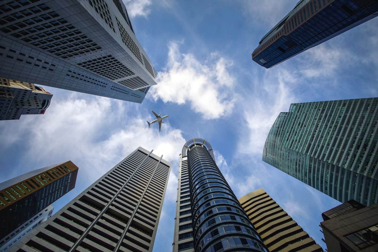 Skyscraper with plane flying overhead