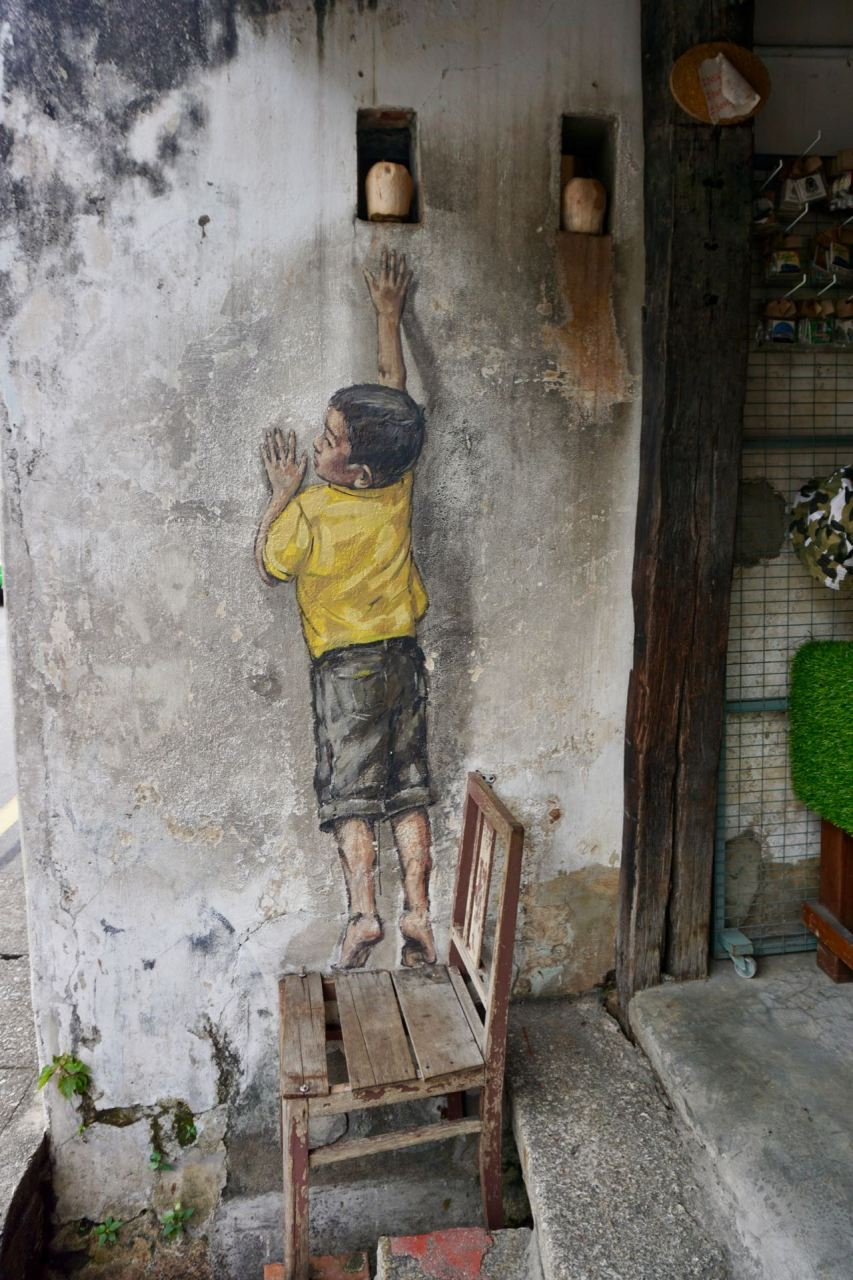 "Streetart ""Boy on chair"" Malaysia"