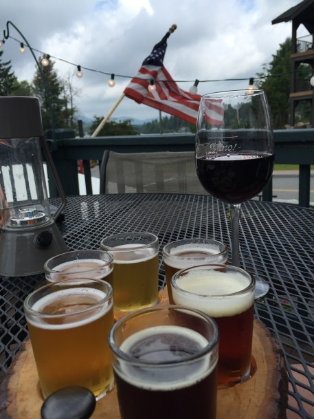A flight and some vino on the deck of Lake Placid Pub