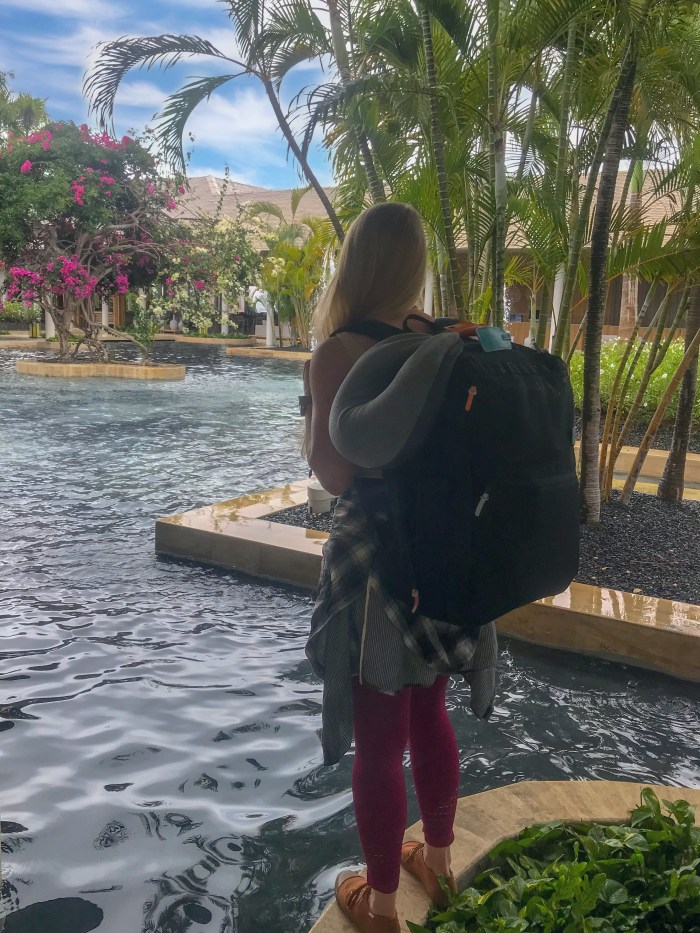 TROPICAL VIEWS WITH STANDARD LUGGAGE CARRY-ON BACKPACK ON GIRLS BACK