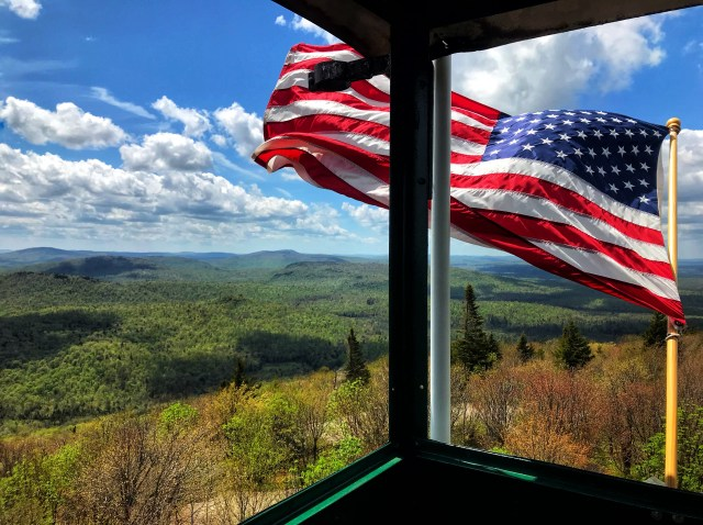 American Flag flies outside a mountain fire tower