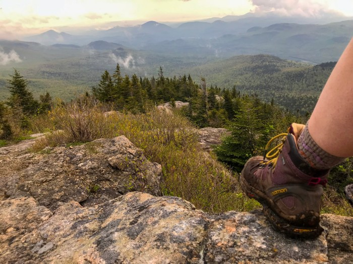 a hiking boot on top of hurricane mountain