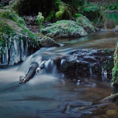 Long exposure of a small cascade in the Jura mountains on a cold day in winter
