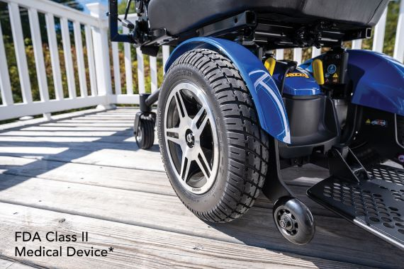 Close up of wheelchair tires and base on a sunny deck outside