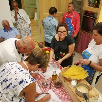 Delight in a hands-on cooking class with a local mamma