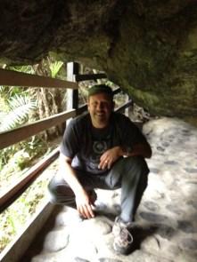 crouching to reach the waterfall