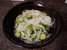 Chopped up onions and cucumbers.