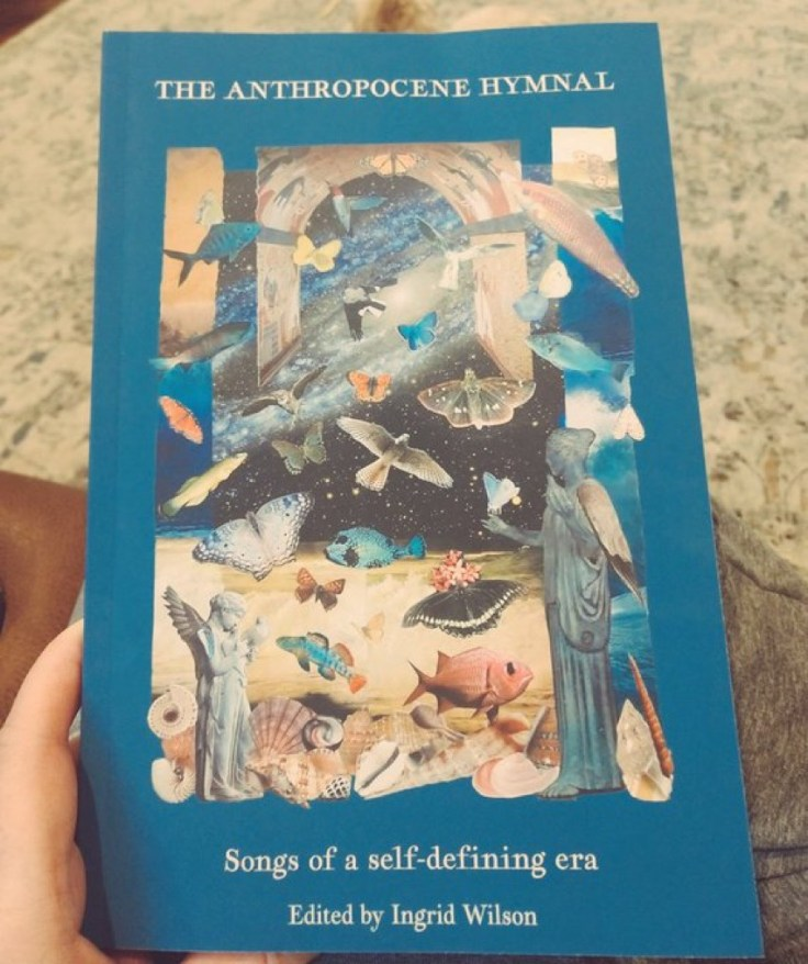 hand holding the Anthropocene Hymnal