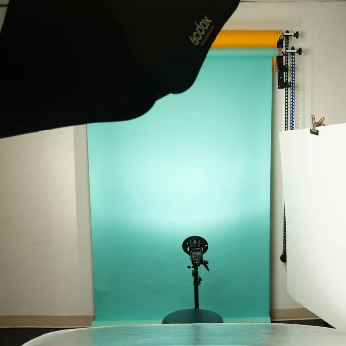 Flash illuminating an aquamarine background