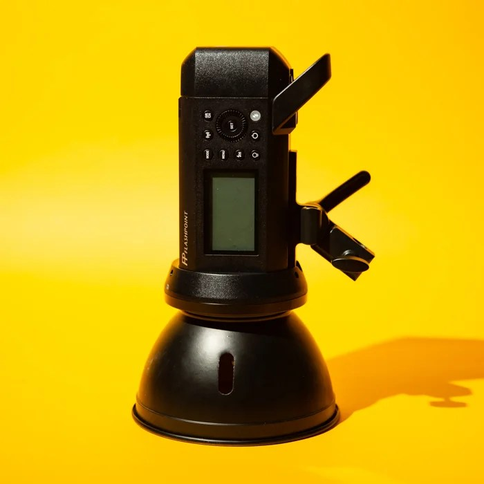 A monolight against a yellow background
