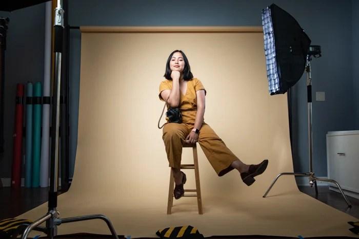 A female posing inside a photography studio