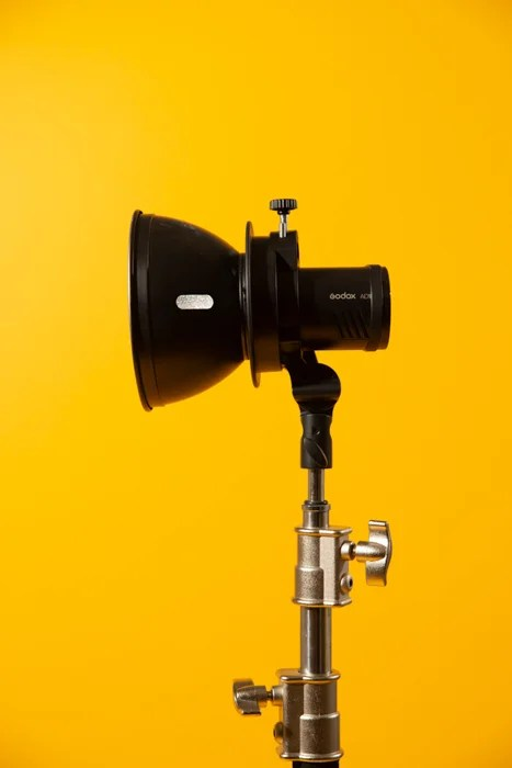 Standard reflector against a yellow background