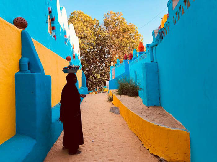 Bright and colourful outdoor travel photography portrait, demonstrating use of contrasting colors for photography beginners