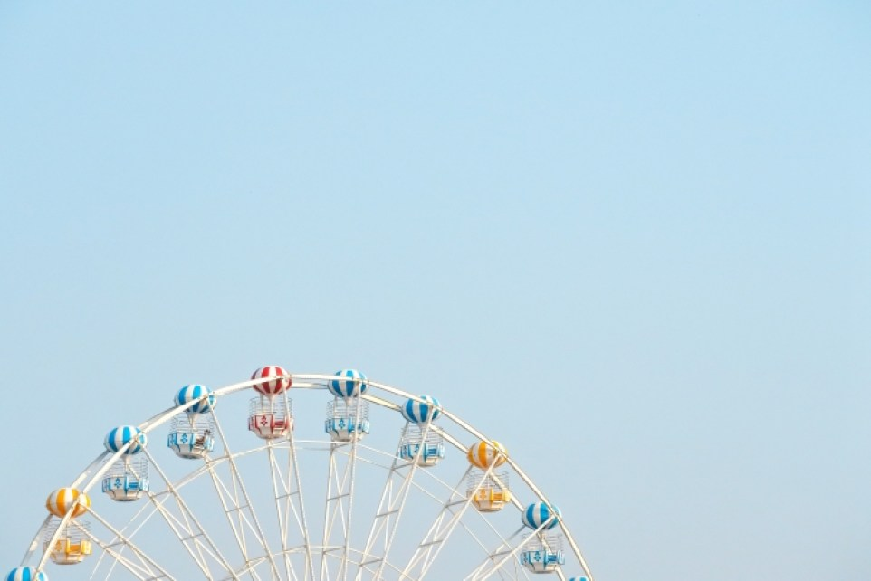 The top of a ferris wheel against a blue sky