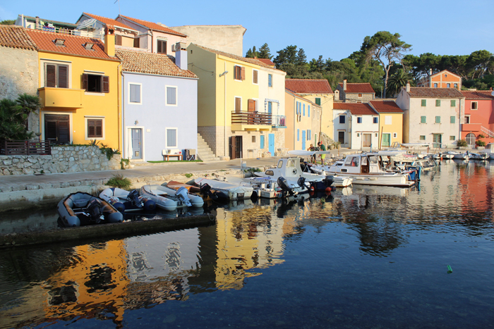 an image of boats docked in front of colourful houses