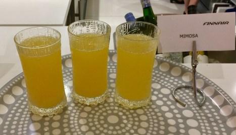 Finnair-Premium-Lounge-breakfast-mimosa-anyone-round-world-trip