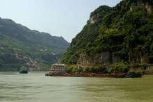 Water levels change seasonally. The Three Gorges Dam keeps levels low during the summer when rain is plentiful. Summers used to bring severe floods, and the dam helps control that. In the winter, the water rises another 20 meters (about 65 feet)