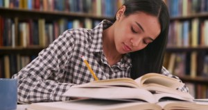 A girl revising her books