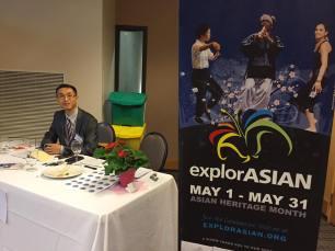 Treasurer John Leung at the reception table
