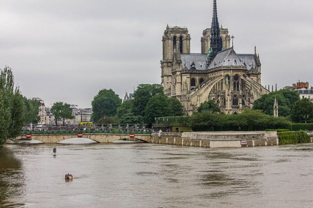 Notre-Dame surrounded by a lot of water.