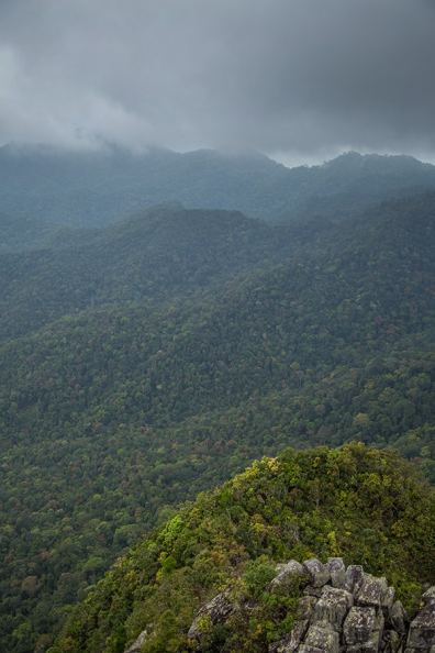 The dark clouds give a dramatic mood to the wild jungle-covered mountains of Langkawi, Malaysia.