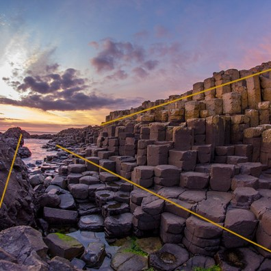 Giant's Causeway, Northern Ireland. The lines lead the eyes straight to the setting sun.