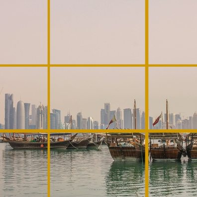 Doha, Qatar. Here the horizon is near the bottom line to make more room for the pretty pinkish sky. The foreground subject (the 3 boats) are around the meeting point of the bottom and right lines.