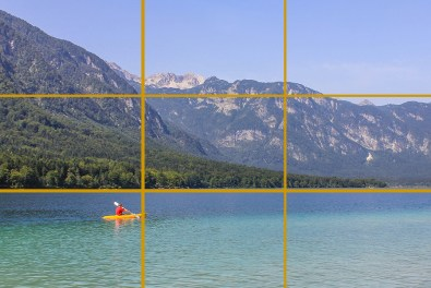 Lake Bohinj, Slovenia. The kayak is near where the bottom and left lines meet. The horizon (here the edge of the lake) follows the bottom line.
