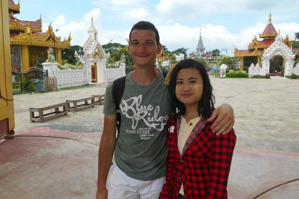 Young girl of Mandalay with the traditional thanaka on the cheeks wanted a pic with me