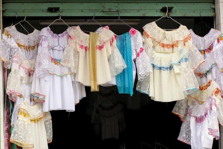 market in Ecuador -ExplorationVacation P1010070 blouses hanging in a doorway