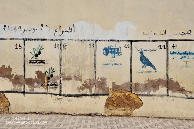 Wall in Fes painted with political party symbols used on the ballot in Morocco - ExplorationVacation