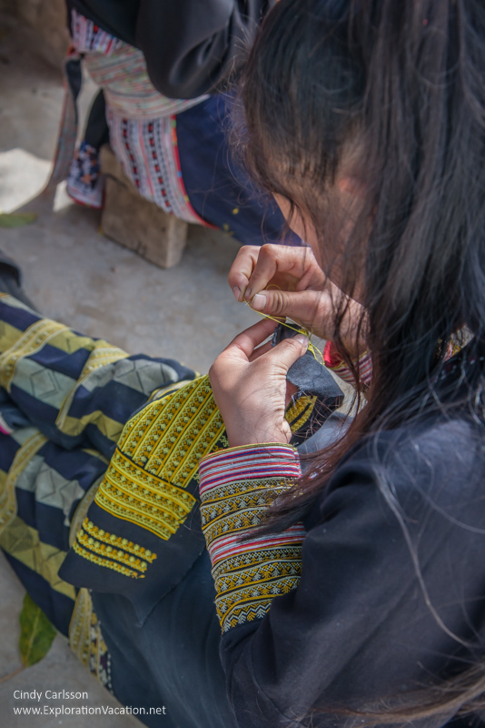Red Dao woman embroidering
