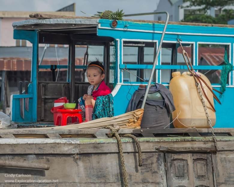 child Cai Rang floating market Vietnam - ExplorationVacation.net