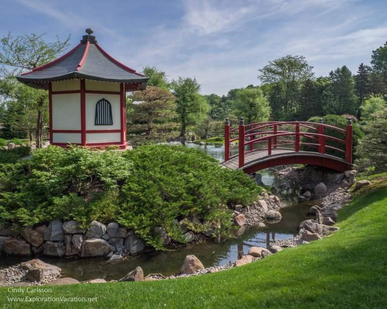 red and white building and bridge in the Japanese garden