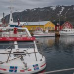 Colorful boats and buildings at the old harbor in Siglufjörður, Iceland
