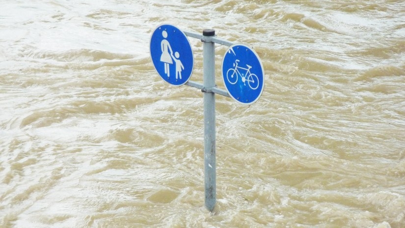 Sign submerged in flood water