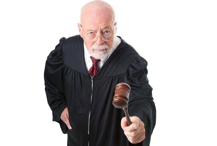No nonsense, skeptical old judge banging his gavel.  Isolated on