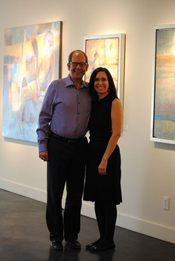 Clark Olson and Christi Bonner Manuelito of Bonner David Galleries, amid works by Max Hammond.