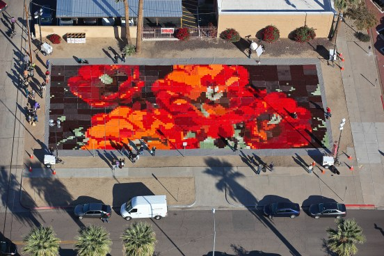 "In an astounding testament to art's place in social practice, Ann Morton created ""Ground Cover"" on a vacant lot in downtown Phoenix. The two-day display consisted of thousands of knitted and quilted squares, assembled into blankets that are now headed to Phoenix's homeless population. Aerial photo courtesy of Ann Morton."