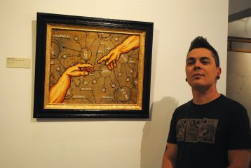 "Jesse Perry with his work ""God Created Adam and Steve"" at monOrchid."