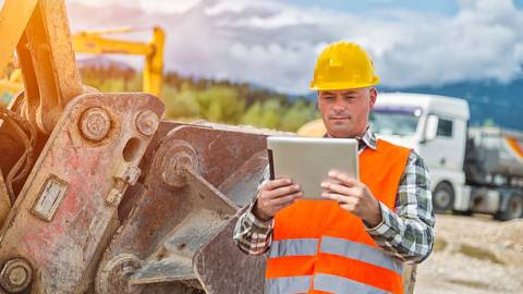 Construction Worker with Computer
