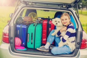 Summer vacation, young girl ready for travel for family vacation