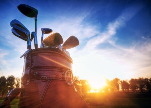 Professional golf gear on the golf field at sunset.