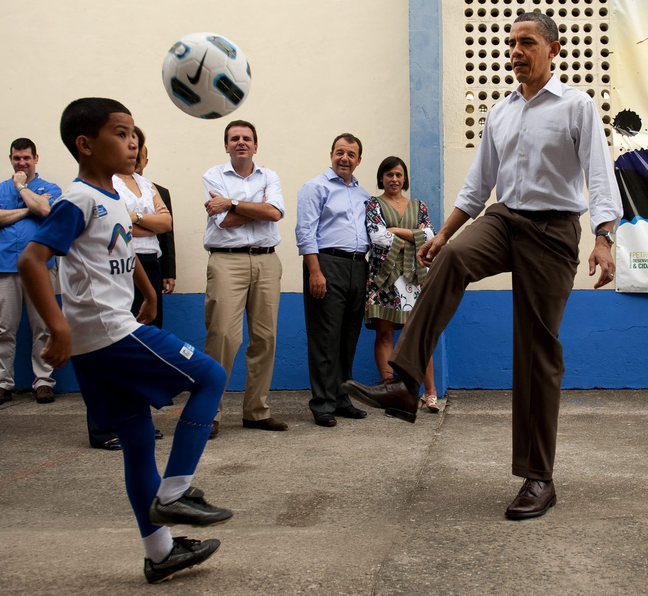 """U.S. President Barack Obama plays soccer while visiting the """"City of God"""" favela in Rio de Janiero, Brazil, on March 20, 2011. (Saul Loeb/Getty Images)"""