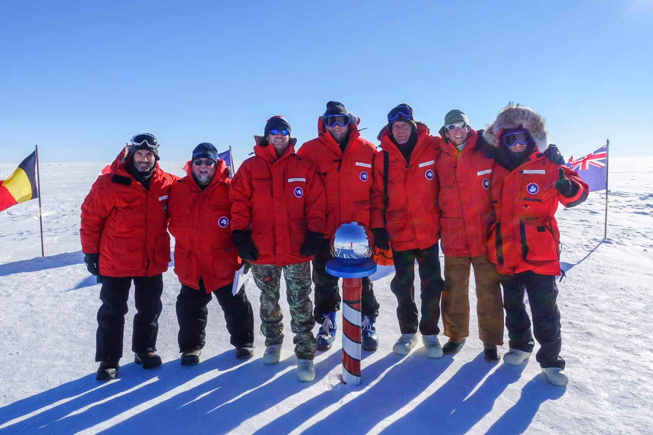 Crew photo at the ceremonial South Pole.