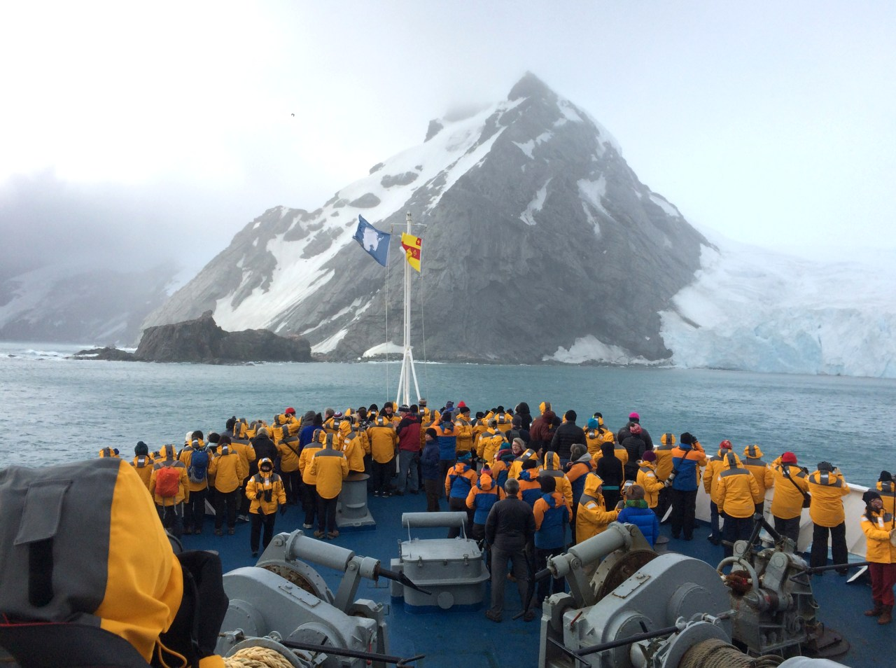 Passengers gather to observe the pittance of rock on Elephant Island.